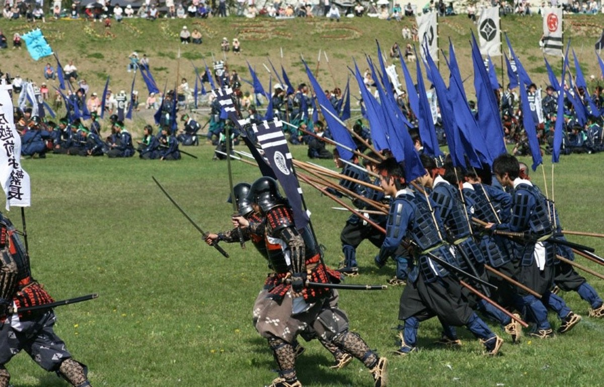 Reenactors, where the samurai leads the ashigaru in a charge.