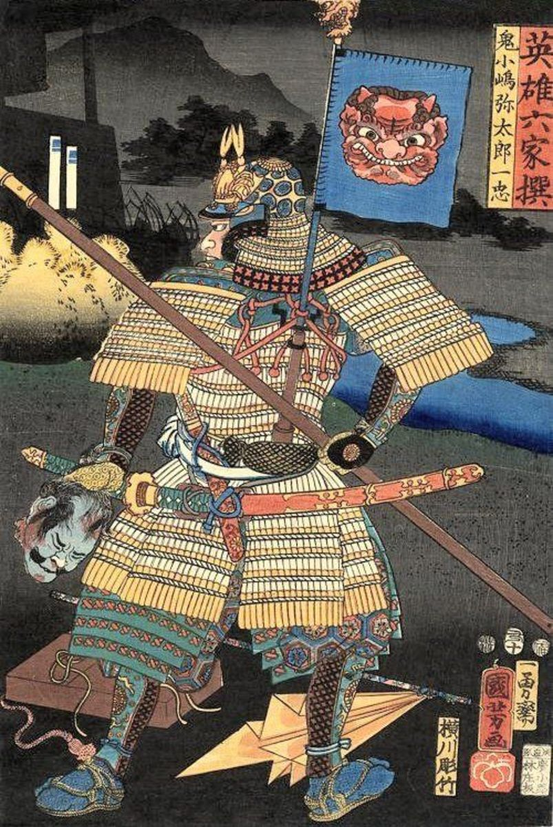 A print of a samurai in armor, holding a severed head.