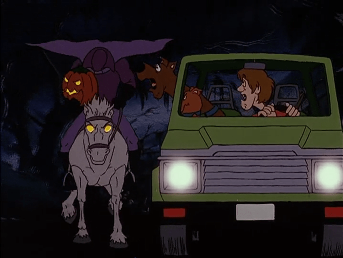 Scooby, Shaggy and Scrappy being chased by a Headless Horseman ghost