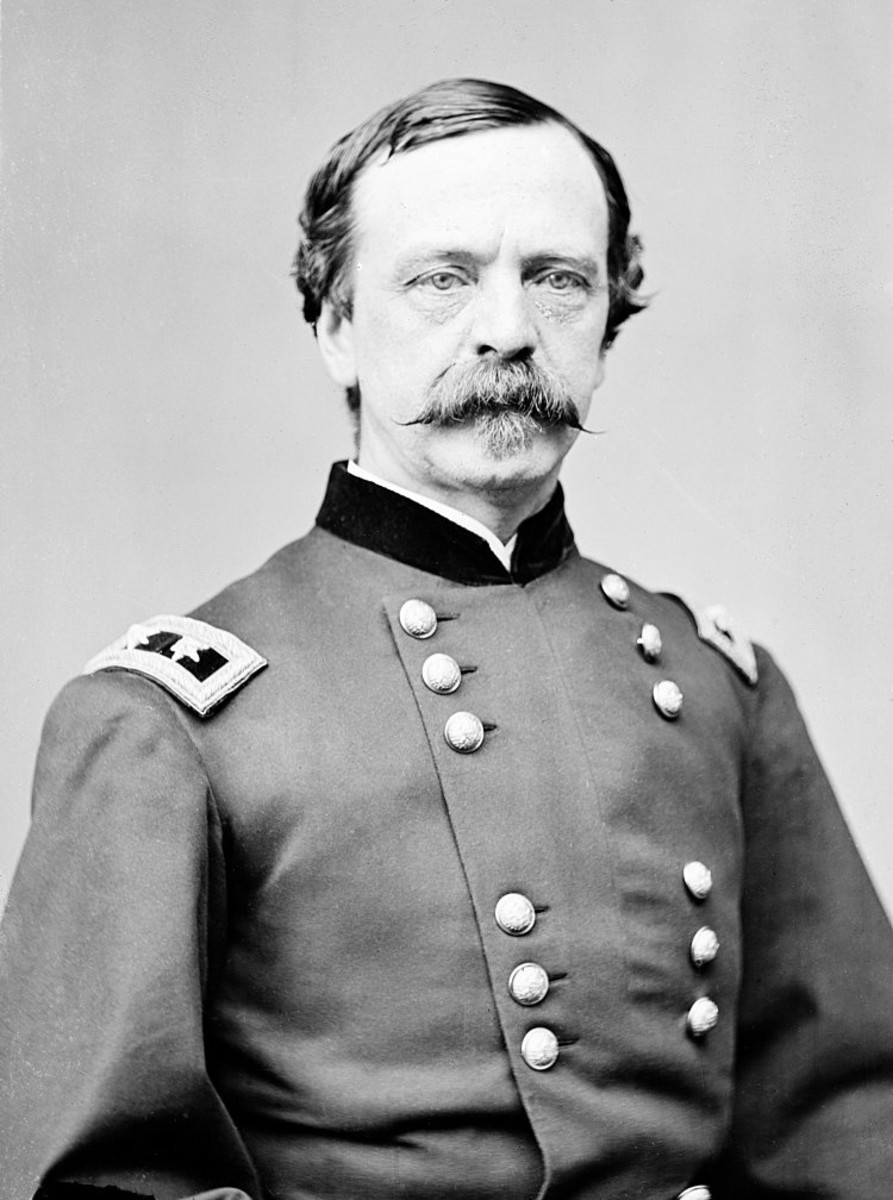 Major General Daniel E. Sickles who moved his troops forward without checking with his commanders in front of Little Round Top giving Confederate troops the advantage of attacking both his flanks.