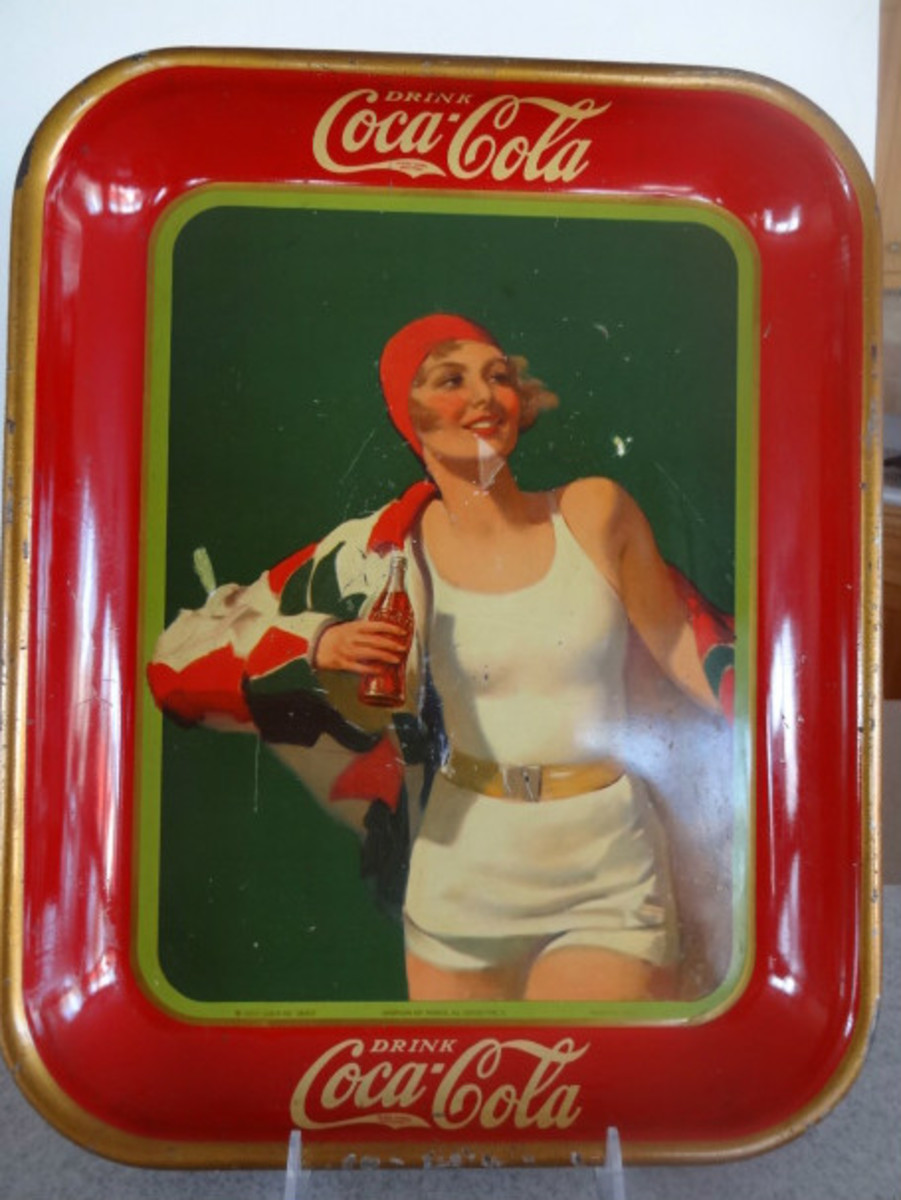 Coca Cola metal tray with blond girl in white swim suit and red swim hat carrying a Coca Cola bottle