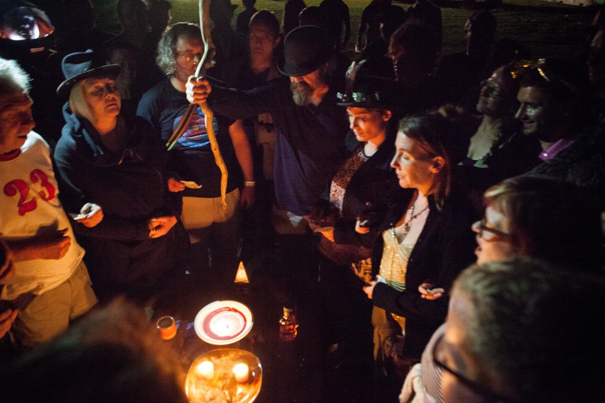 F23 money burning ritual with Jon Harris (in bowler hat). Photo Dan Sumption danshotme.com