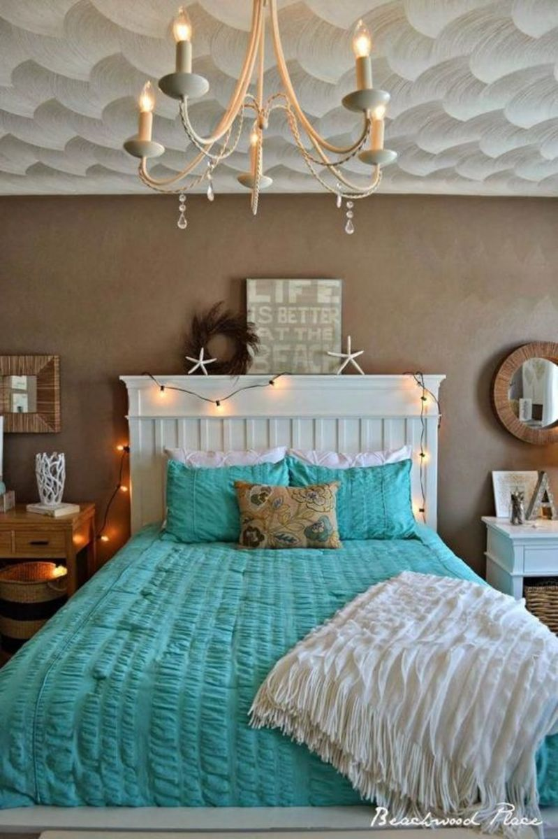 Keep an ocean or water theme in the bedroom. Chandeliers and mirrors are fantastic touches for Pisces vibes.