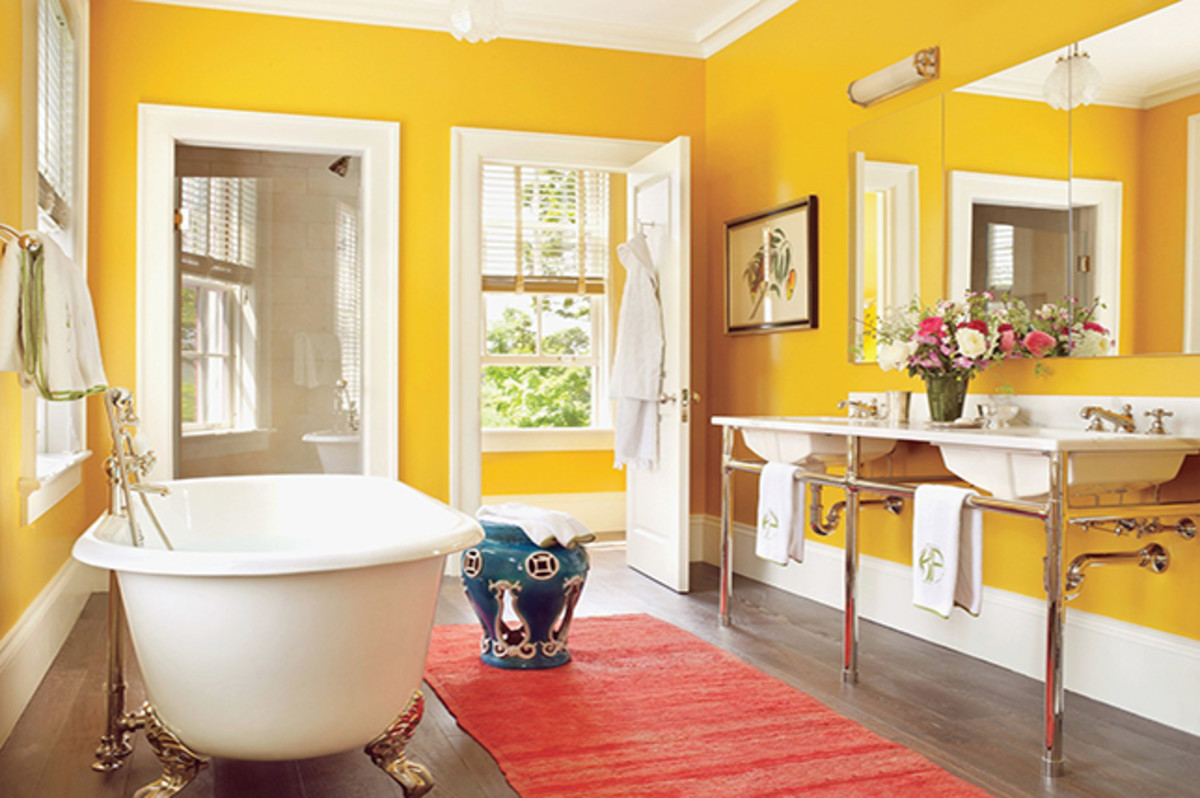 A yellow bathroom is perfect for Gemini. Throw in some flowers and two sinks, and it'll feel like home.