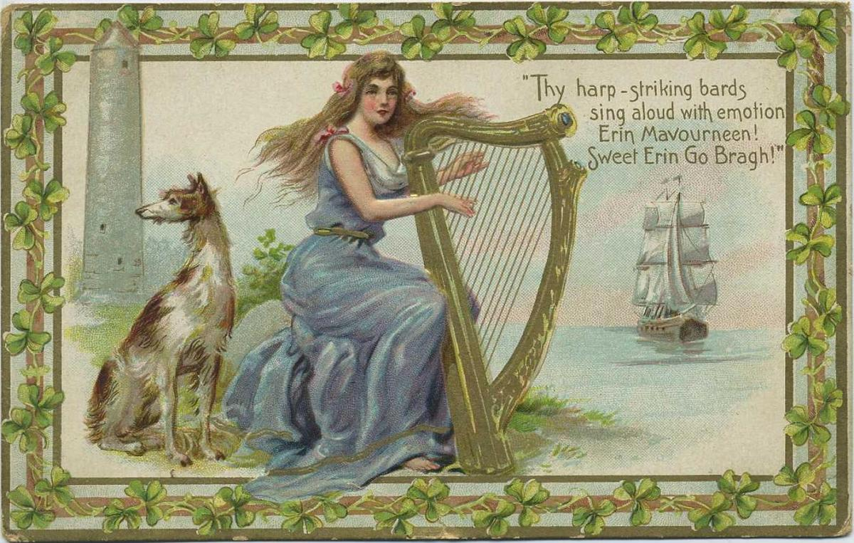 Vintage greeting card: Pretty woman dressed in blue gown playing a gold harp in front of Irish sea scene