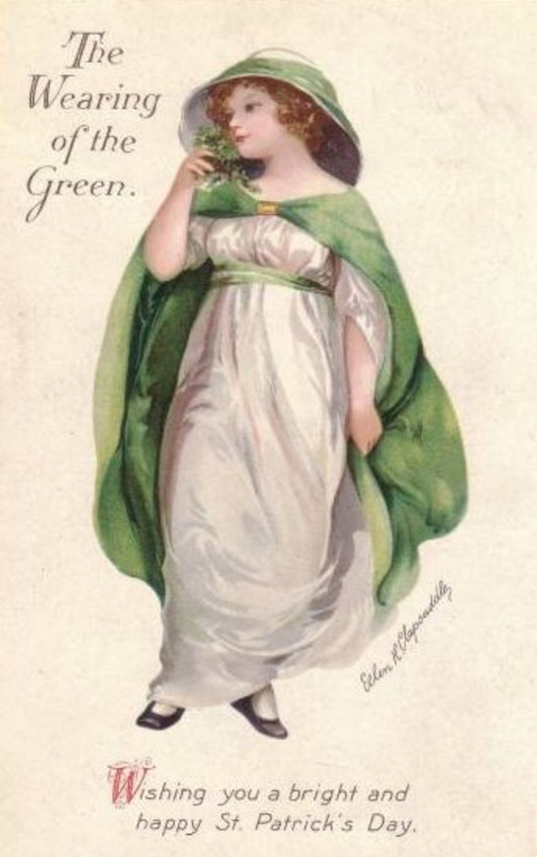 Vintage Irish pretty woman wearing a white gown and green cape for St. Patrick's Day