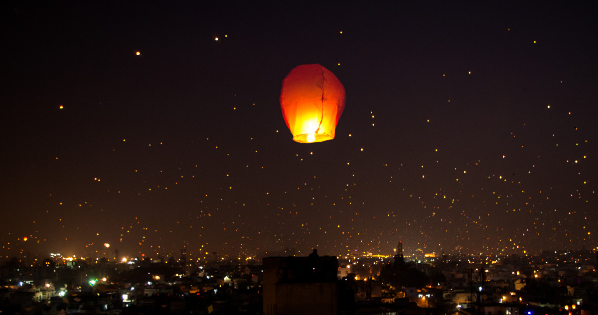 The Night Lit Up on Makar Sankranti Uttarayana Festival with Kites and Lights.