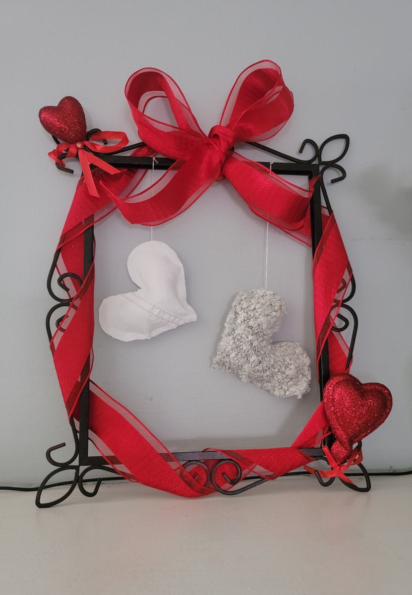 This DIY Valentine's picture frame wreath is just adorable! Customize it to your heart's content.