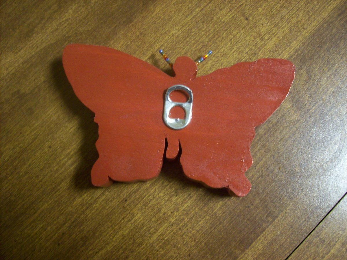 Wooden butterfly with aluminum pop top hangar