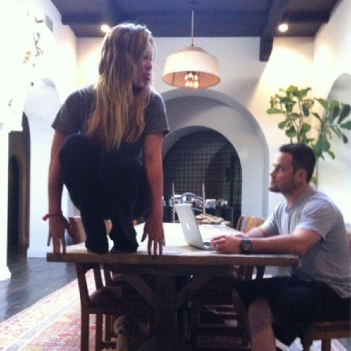 Hilary Duff tweeted this picture of herself Owling. Her husband Mike Comrie looks at her from the corner of his eye.