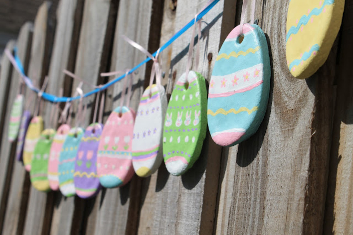 Bright Hand Painted Easter Eggs Comprises this Easter Garland on an Exterior Railing