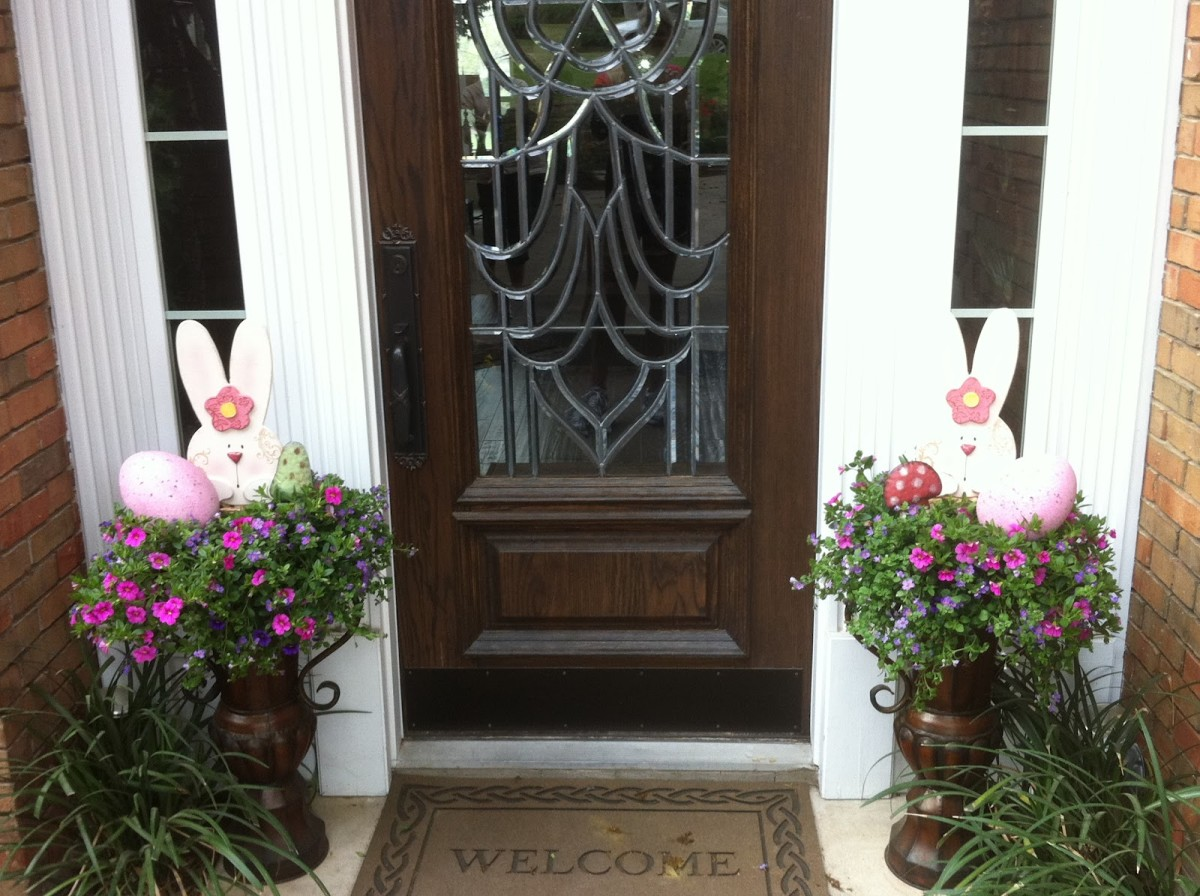Front Door with Easter Decorations with leaded glass entry door with Easter bunnies in the side planters