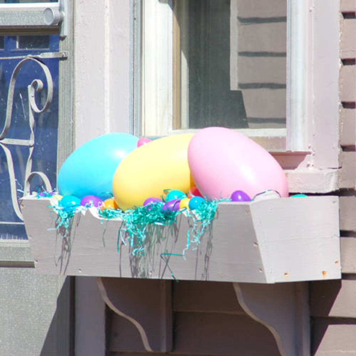 Easter Eggs of Turquoise Blue Yellow and Pink in a Window Box