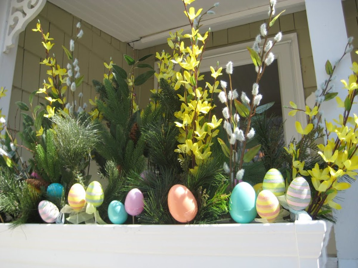 Easter eggs in bright blue, orange yellow and green adorn an exterior porch railing