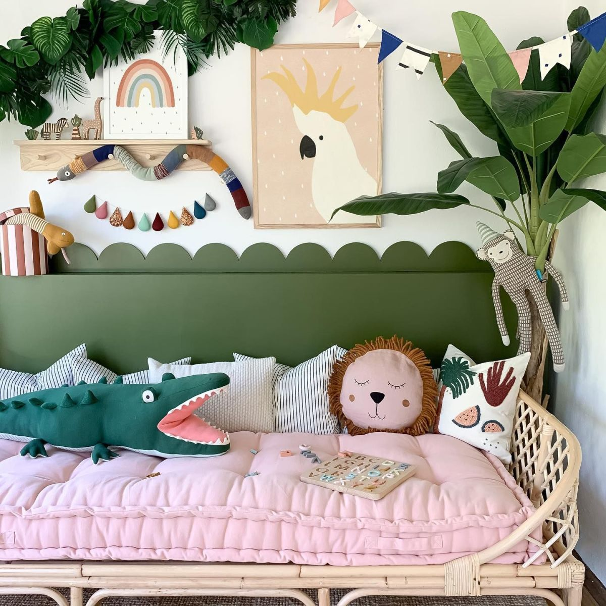 Kids pink and green decor. Jungles art theme for children's room. The rattan children's furniture. A neat rainbow wall art!
