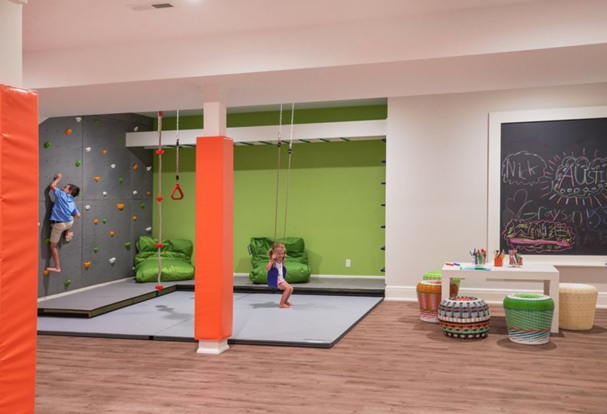 Basement play area has the foam mats. The monkey bars, trapeze rings and rock-climbing walls