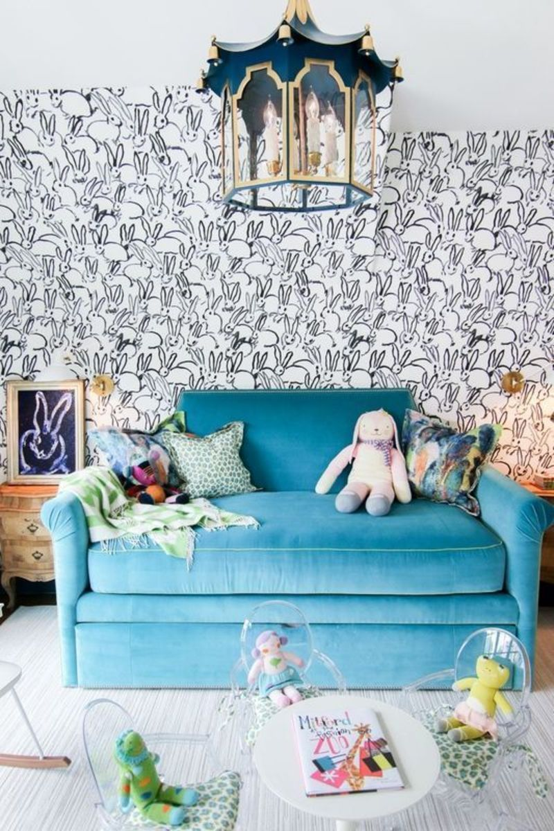 This kid's play room that is for a toddler or the child in the velvet sofa!