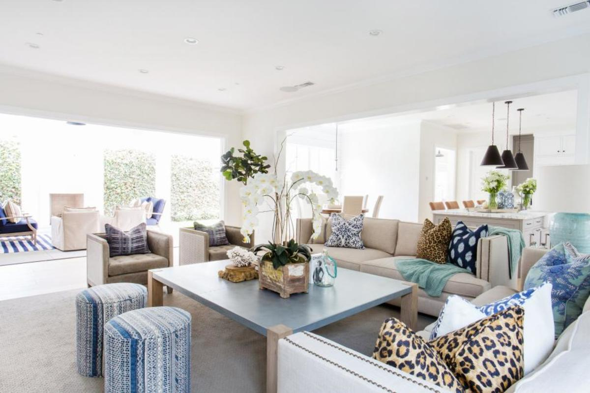 Layer throw pillows and beautiful furniture colors. This stylish space for the whole family.