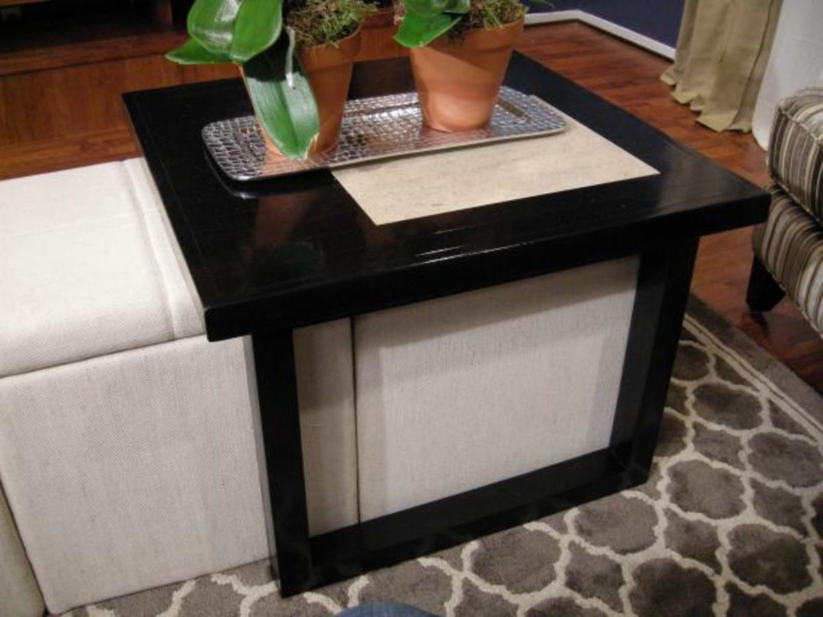A custom coffee table made to slide over a set of ottomans.