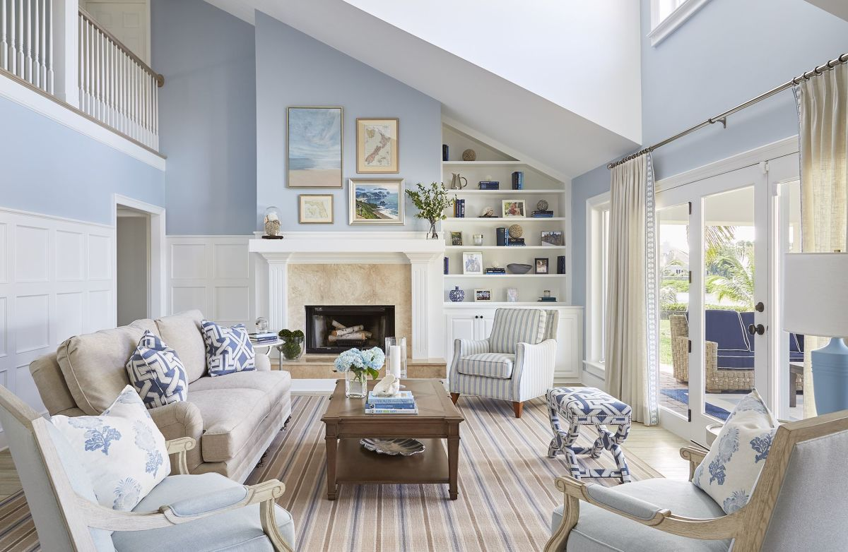 The Cancer living room should have beach house vibes. Paint the walls in a light or medium blue shade.
