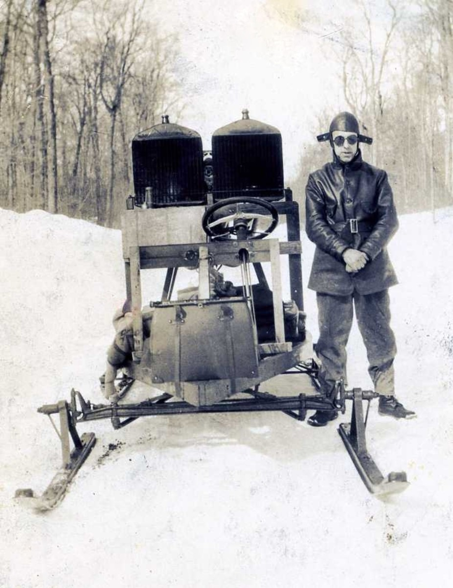 My Grandfather, Ed Spencer, with one of his homemade snowmobiles -- Note: the mailbag in the front
