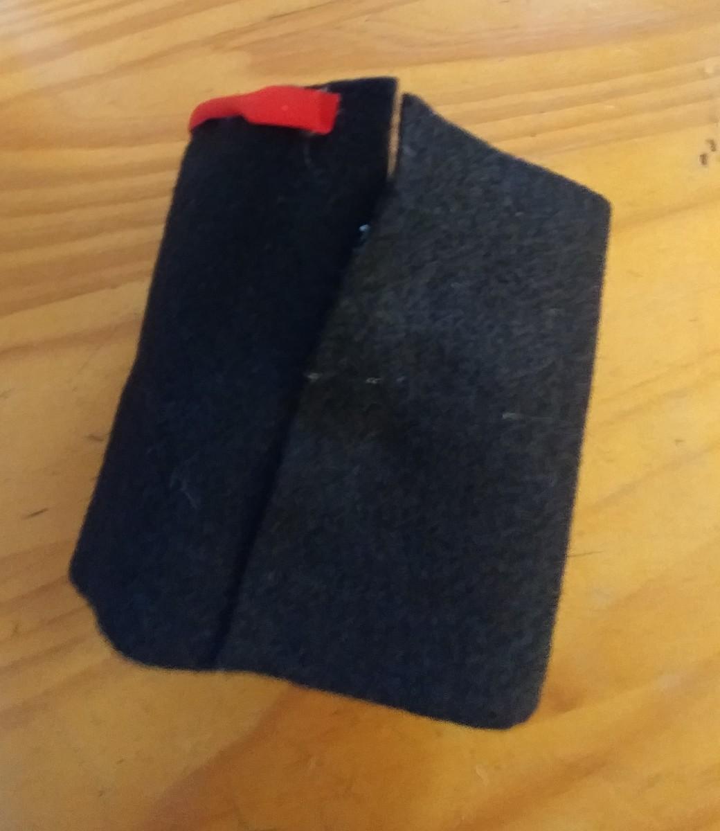 Use glue gun to glue back of felt together. Only glue half way up.
