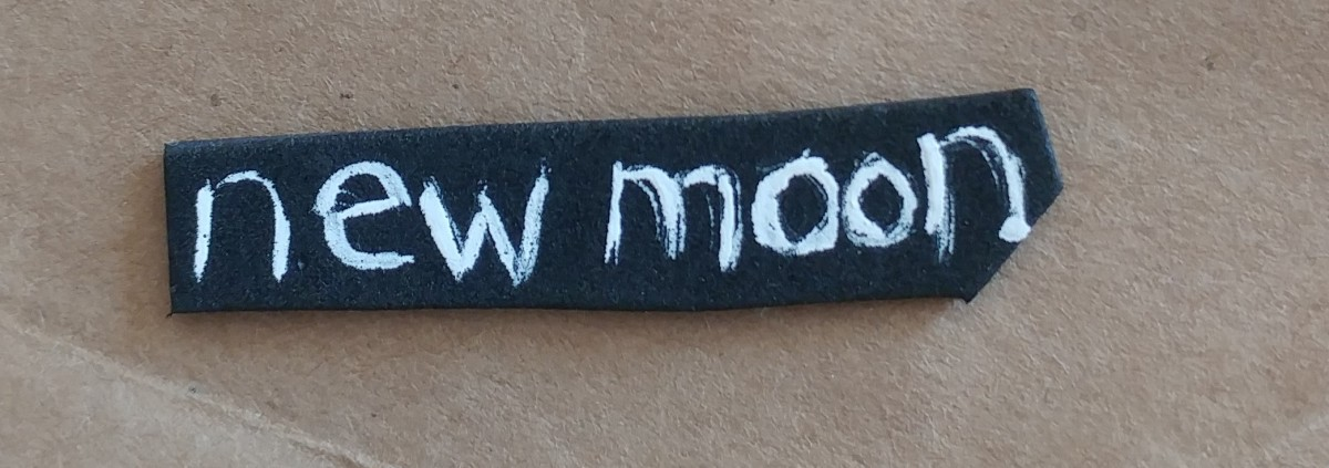 Cut out a peice of black foam sheet, to paint the title of New Moon.