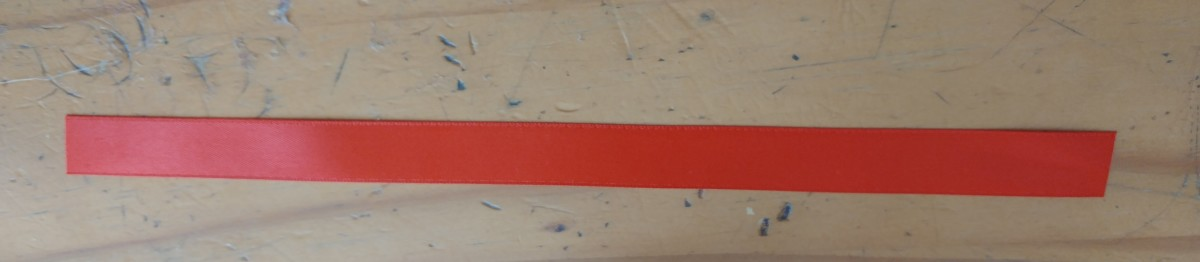 Cut a peice of red ribbon, as long as you like, this one is 8 inches long.