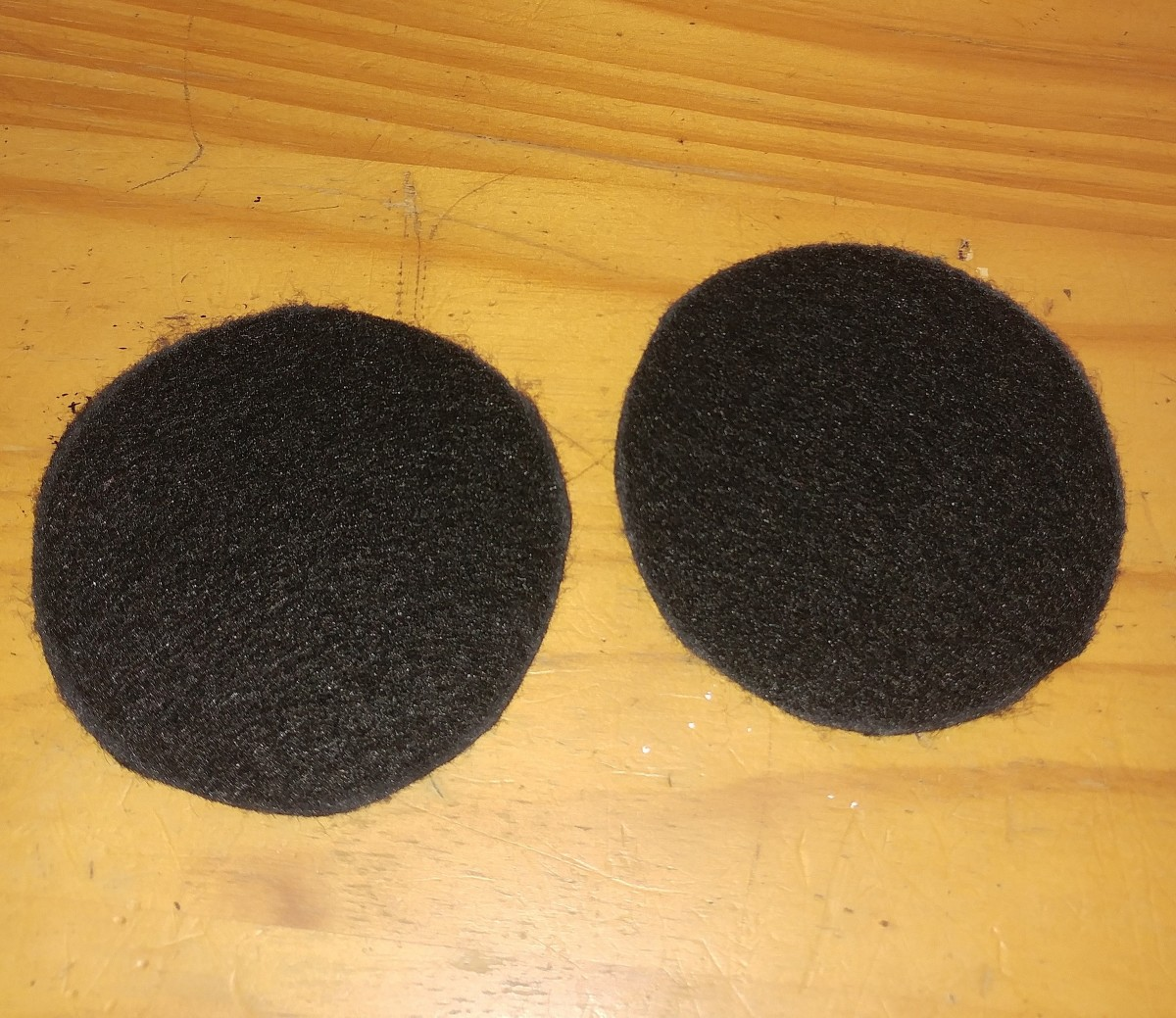I Used a mason jar lid to measure a perfect circle. You may use white chalk to draw around lid on the black felt. The chalk makes it easier to see what your going to cut out.