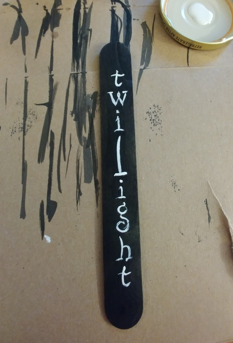 Paint twilight with white paint. I used the font used for the Twilight book cover.