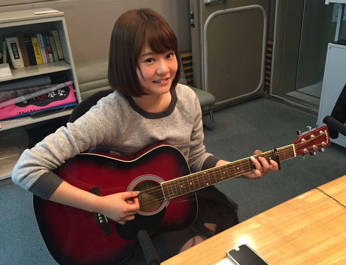 Could Chihiro Anai become a rock star one day? She looks very happy playing the guitar.