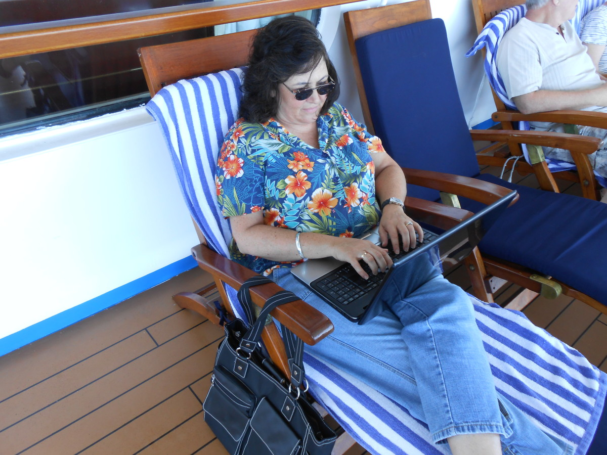 One of the things I love about a writing career is the flexibility of where one can work. Here I am at work on an article on the Promenade Deck of a cruise ship!