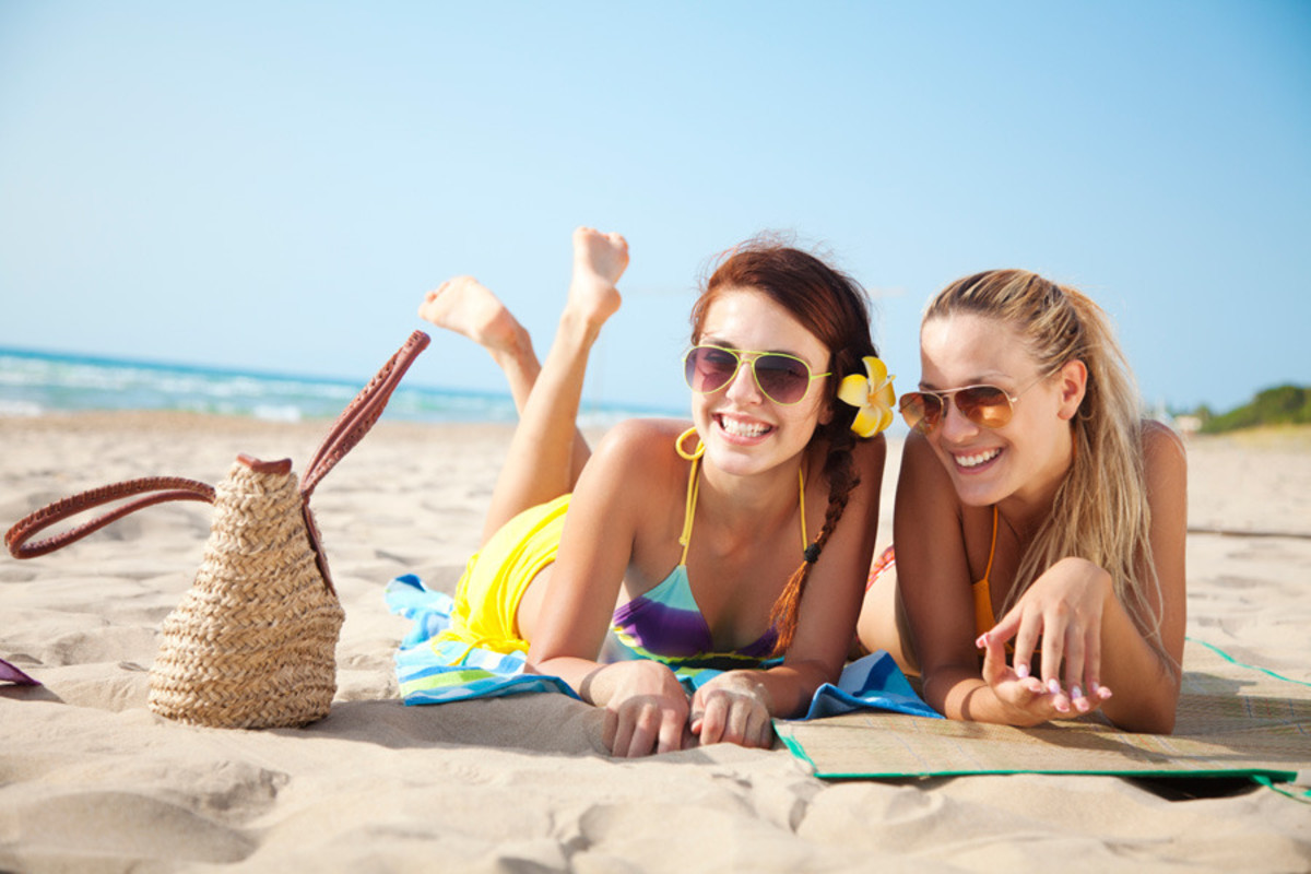 Female friends vacationing at a beach destination