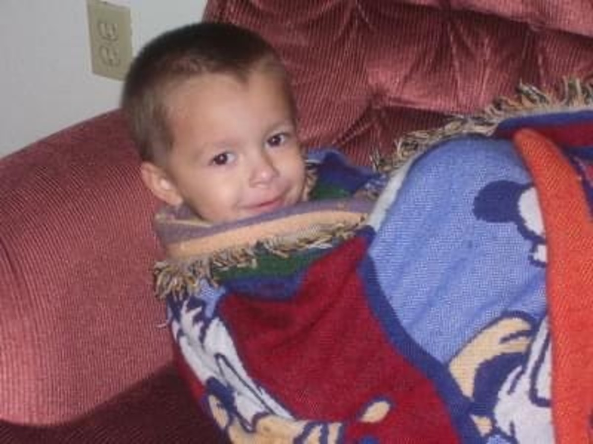 """Andrew Gabriel December 2006, 4 years old Dad deployed: 2 weeks Recent doctor stated, """"He doesn't look Autistic."""""""
