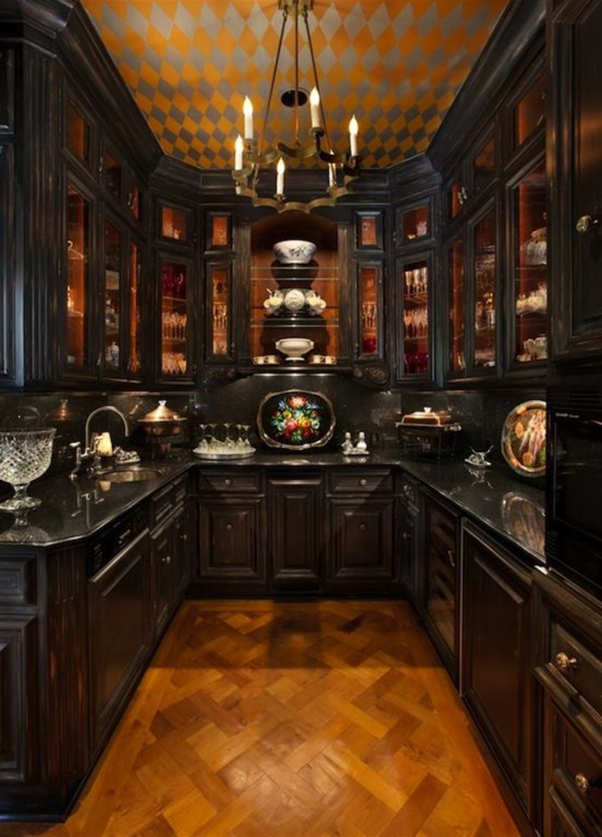 Put cups, bowls, and plates on display in the Scorpio kitchen. Opt for gothic elements.
