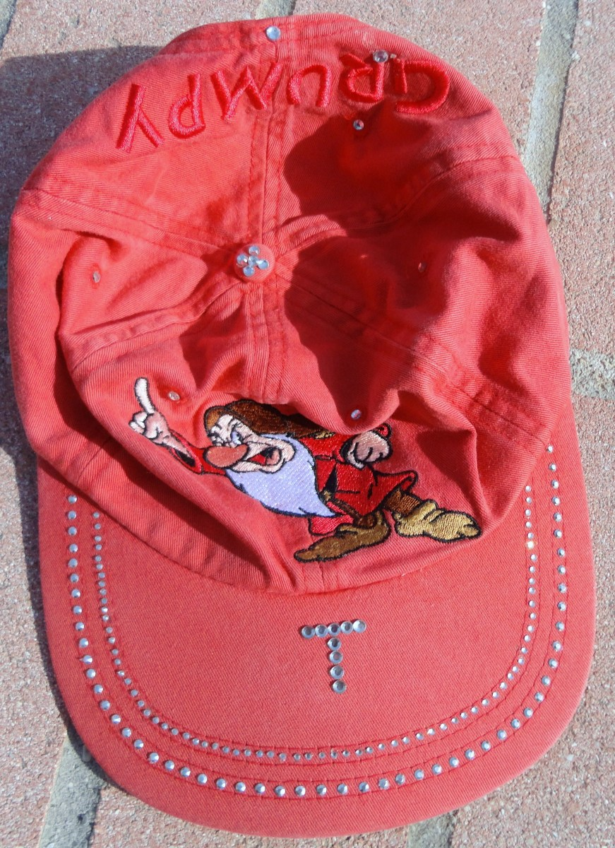 This is a hat I bought at Walt Disney World in about 1995 or 1996. I updated it with clear rhinestones and silver rhinestuds to make it more personalized.