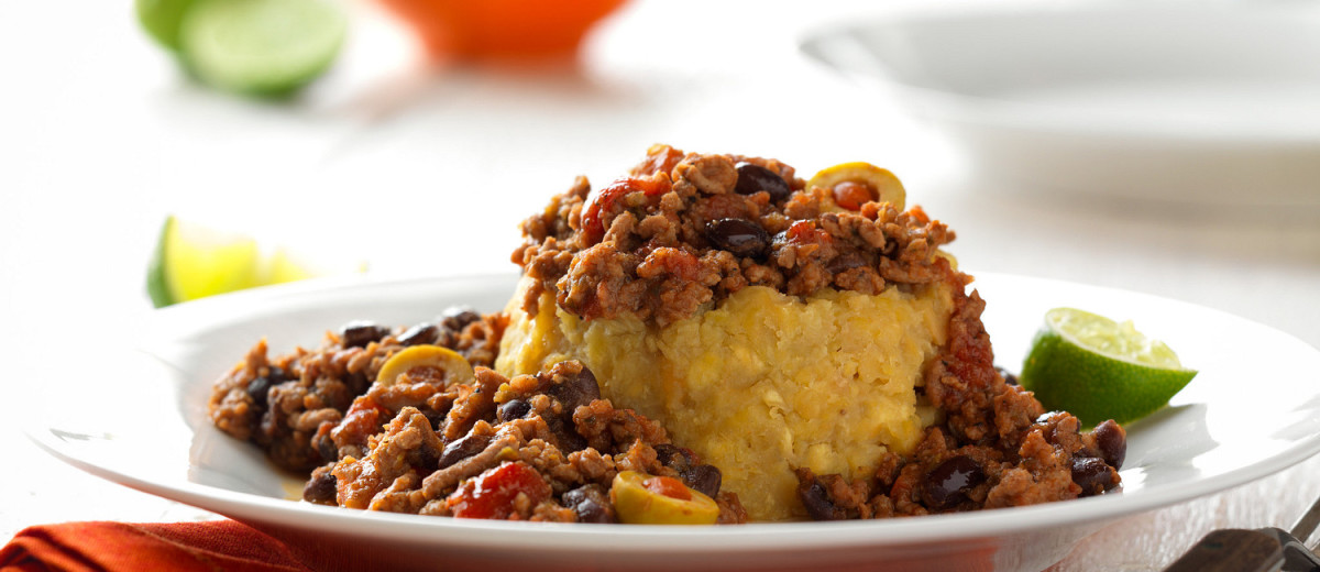 Mofongo topped with fried shredded beef. Asere in La Placita did a similar presentation to this.