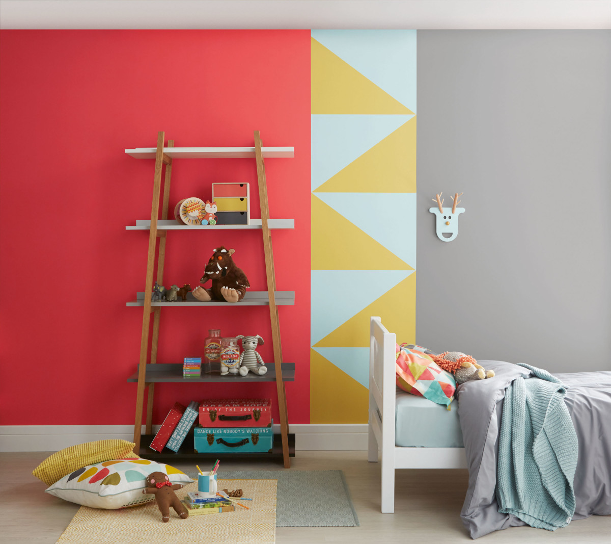 A children's bedroom looks great with red, white, and yellow walls. Add triangles into the design to bring out fire energy.