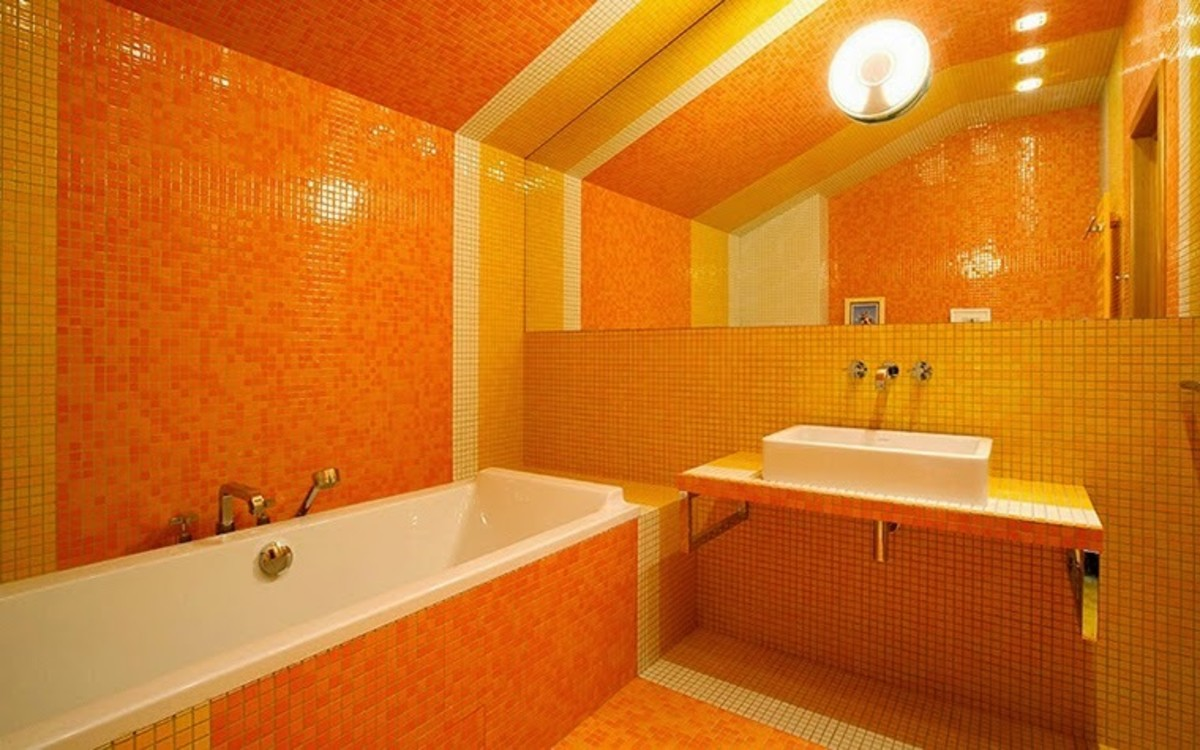 For fire energy: opt for a rectangular bathtub. Orange is a great color for the interior of the bathroom. Tiny tiles repeat the square shape.