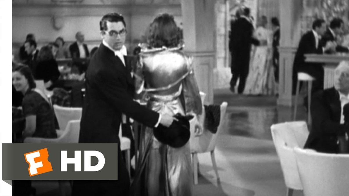 Cary Grant shielding Katherine Hepburn from embarrasment
