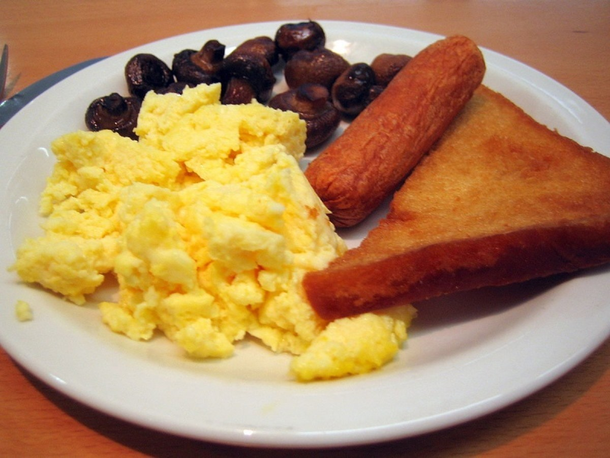 Scrambled eggs with veggie sausages, mushrooms, and fried bread makes a delicious breakfast or lunch.