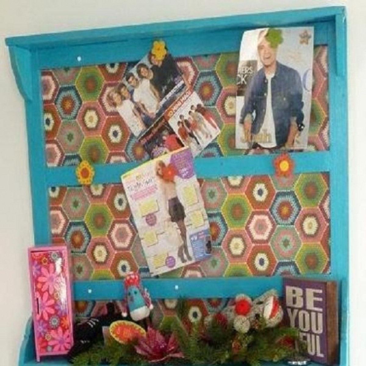 Close-up of Bulletin Board Detail - Cork board is covered with wrapping paper coordinating with room's color scheme and reinforces the floral motif.