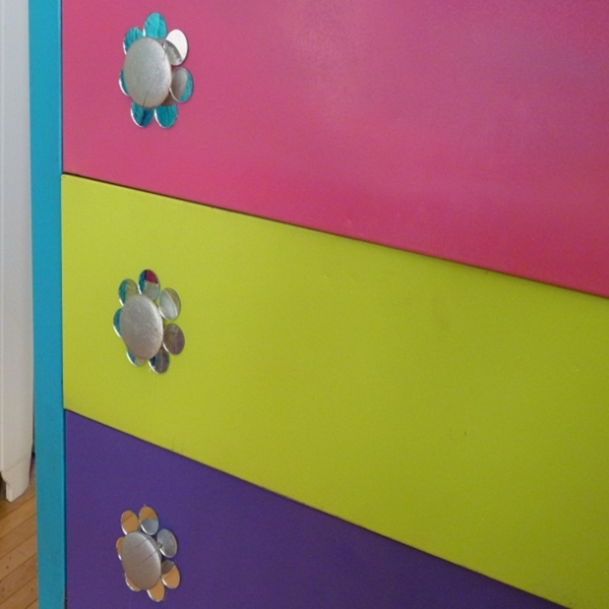 Upcycled DIY Dresser Drawer Detail - Drawers painted in colors to reinforce room's palette.