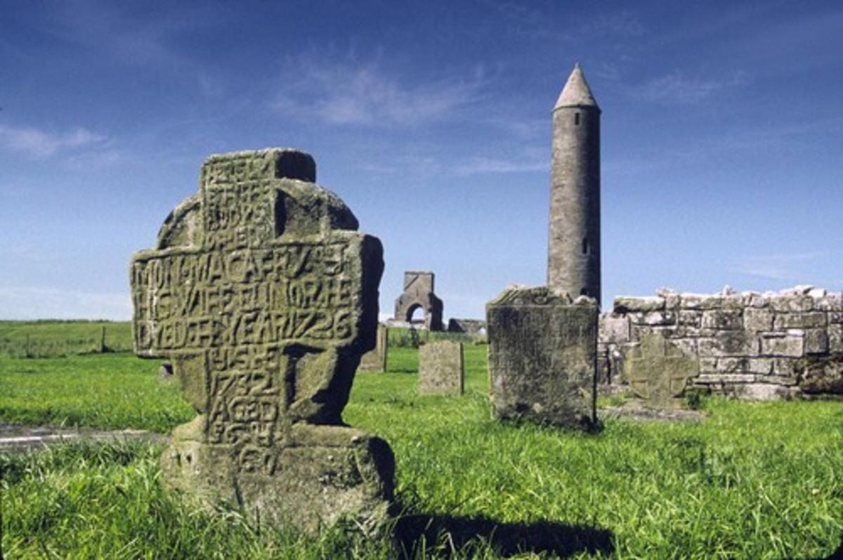 Devenish Island, N. Ireland.  Notice the round tower built by the Celts and very typical of their architecture.   Also, notice the Celtic cross.  N. Ireland was Christianized by St. Columba.