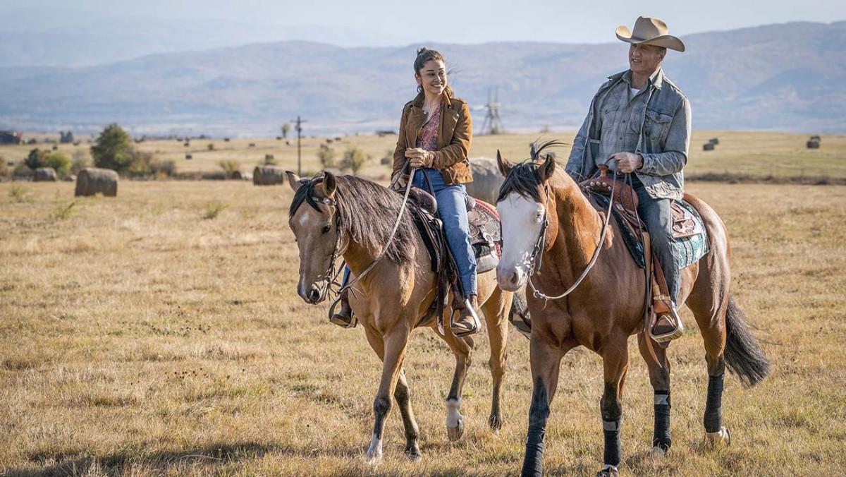 John Rambo and Gabriela riding their horses