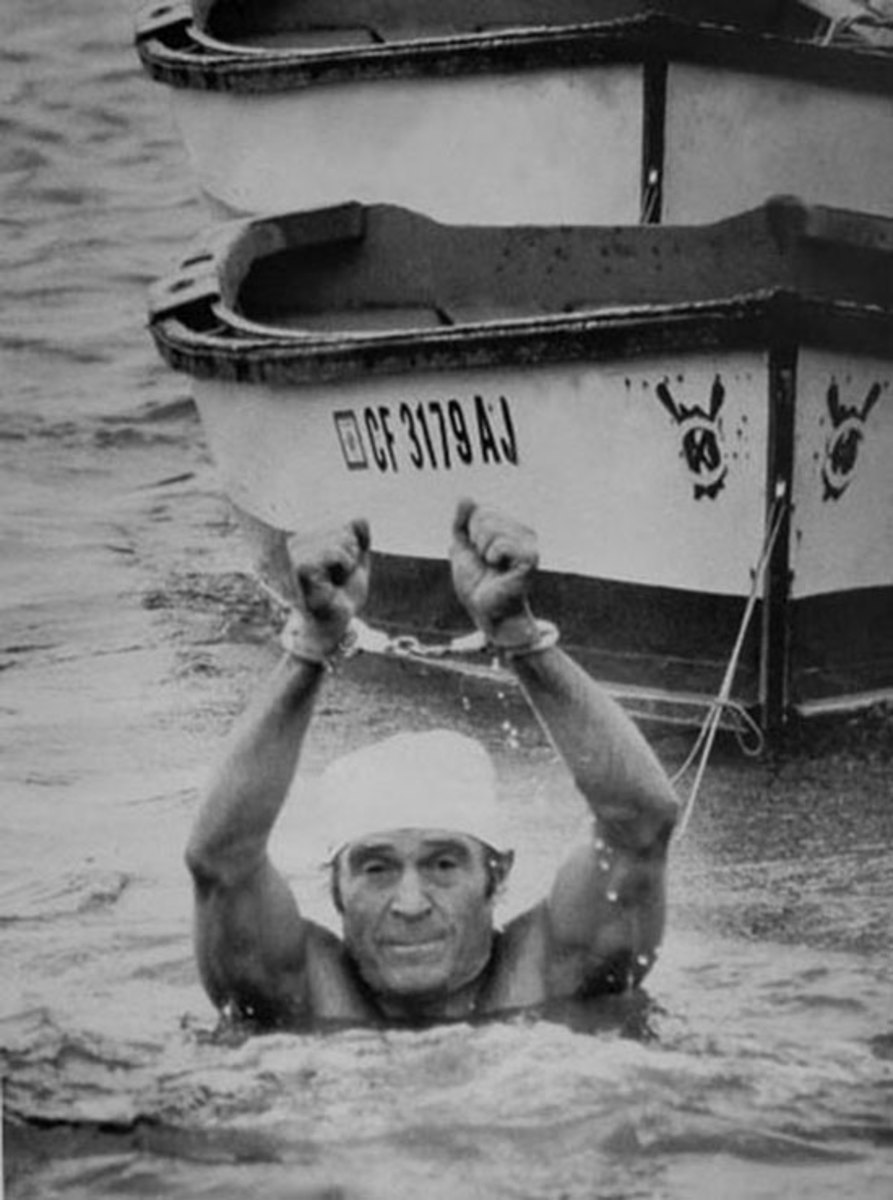 Jack LaLanne-- 1,033 push-ups in 23 minutes, and swimming from Alcatraz to San Francisco in freezing ocean water while handcuffed and shackled.