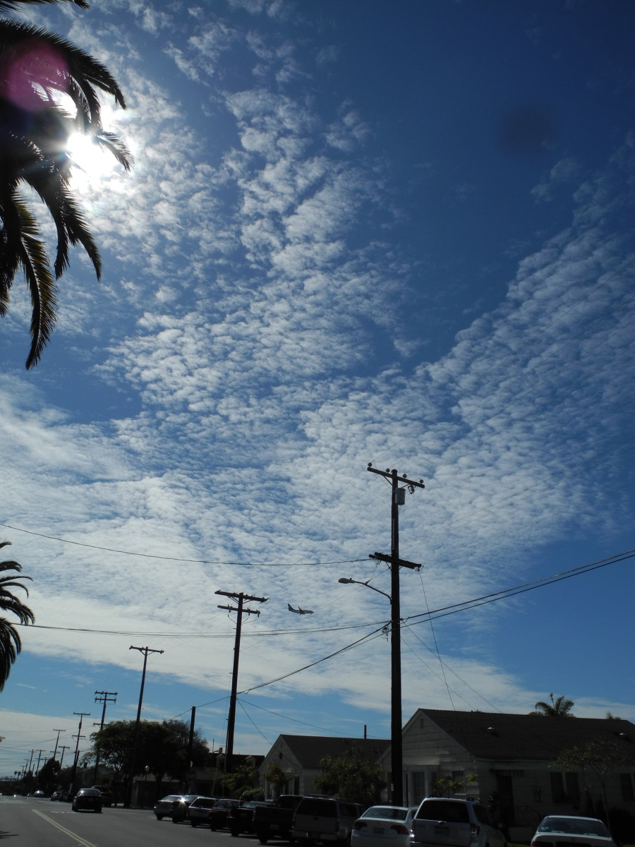 These are NOT Clouds, these are Chemtrail Cloud Formations.  Notice the Key Hole Punch type clouds, HAARP Activity... almost like cotton balls.