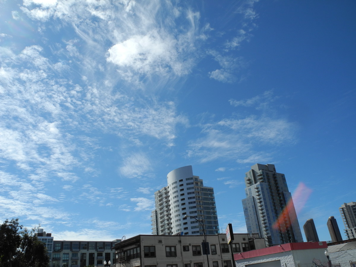 Buildings surrounded by this Baking Soda Consistency Cloud Formation from the Fall Out of Chemtrails.