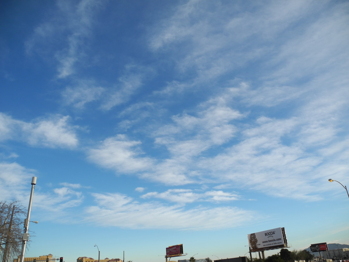Winds carry the chemicals, gradually the clouds shape into smaller cloud-like formations.  (Swiss Cheese, compared to Cottage Cheese) called a Keyhole Punch Cloud.  But the air quality and dryness, still cause you to gasp for air.  (((NOT a cloud!!!