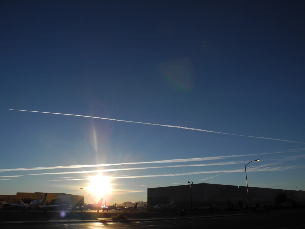 Another angle of the initial Pencil Thin Type lines that you see when the planes spray the Aerosol jet spray Chemtrails.  Glistening like a Spider Web in the Sun.